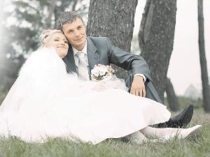 Игорь и Юлия Клочко дату свадьбы выбирали интуитивно. И довольны. Фото Елизаветы ТОМАШЕВСКОЙ.